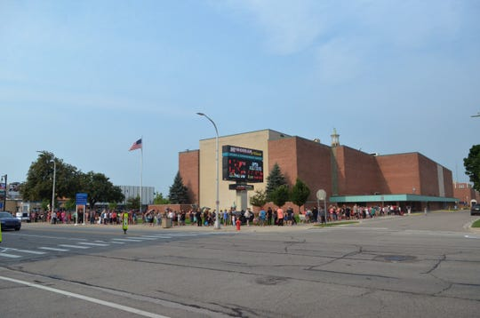 The line wraps around McMorran Place for the Port Huron's 16th annual backpack giveaway on Aug. 15, 2018, in Port Huron.