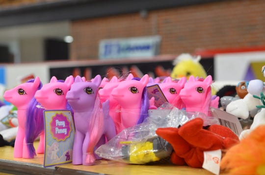 Small toys sit on a table at Port Huron's 16th annual backpack giveaway on Aug. 15, 2018, in Port Huron.