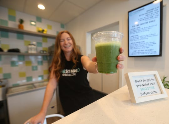 Laura Leigh Abby serves up a fresh green smoothie at The Studio @ Beacon on August 13, 2018.