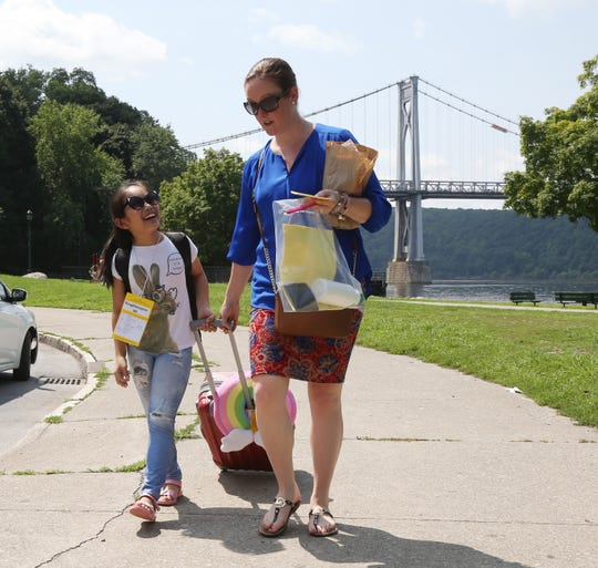 Kate Rabe of Beacon walks with Erica Jiang at Victor C. Waryas Park in the City of Poughkeepsie on August 15, 2018. Jiang, 10, of Brooklyn is in her fourth year with the Fresh Air Fund, and is looking forward to whatever the week brings.