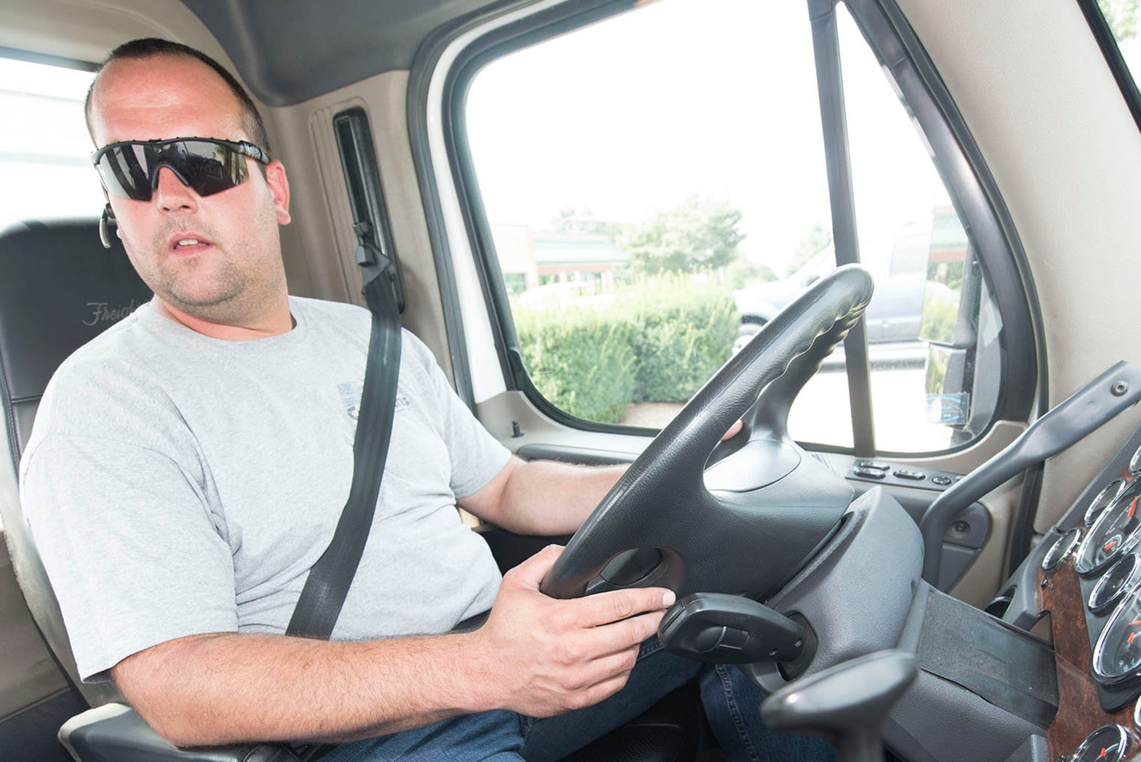 Zachary Black, a driver at Franklin Logistics and Development, Chambersburg,  sits in the cab of his truck before hitting the road. There is a nationwide trucker shortage and that could affect the time it takes goods to reach shelves.