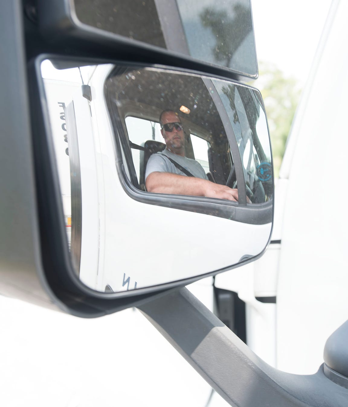 Zachary Black, a driver at Franklin Logistics and Development, Chambersburg,  inspects his truck before hitting the road. There is a nationwide trucker shortage and that could affect the time it takes goods to reach shelves.