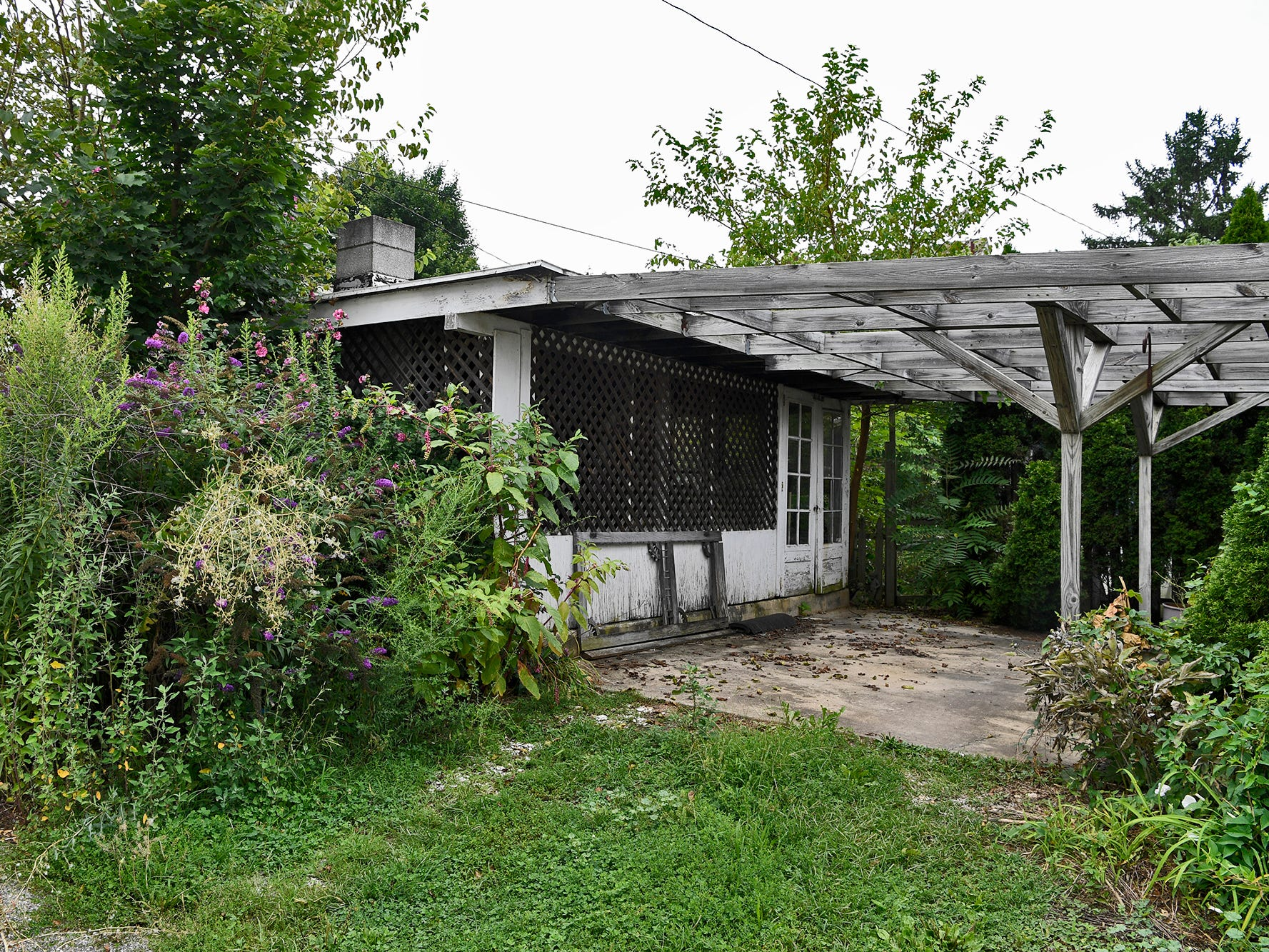 A residential property at the corner of Orange and N. Clinton Streets is overgrown and in disrepair according to West York Borough Codes Enforcement Officer James Hope.  Police Chief Matthew Millsaps says that there are at least 30 properties currently being pursued for cleanup. Wednesday, August 14, 2018. John A. Pavoncello photo