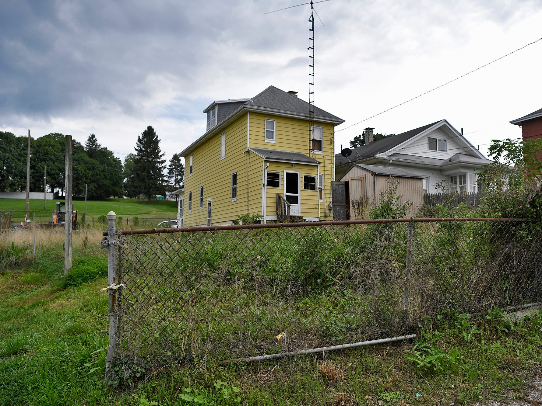 West York Borough Police and the Borough Codes Enforcement office are teaming up to fight blight. Police Chief Matthew Millsaps says that there are at least 30 properties, including this one two doors down from the Borough office, currently being pursued for cleanup. Wednesday, August 14, 2018. John A. Pavoncello photo