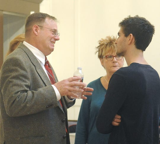 Sheriff Al McNeil talks with people after the candidate forum.