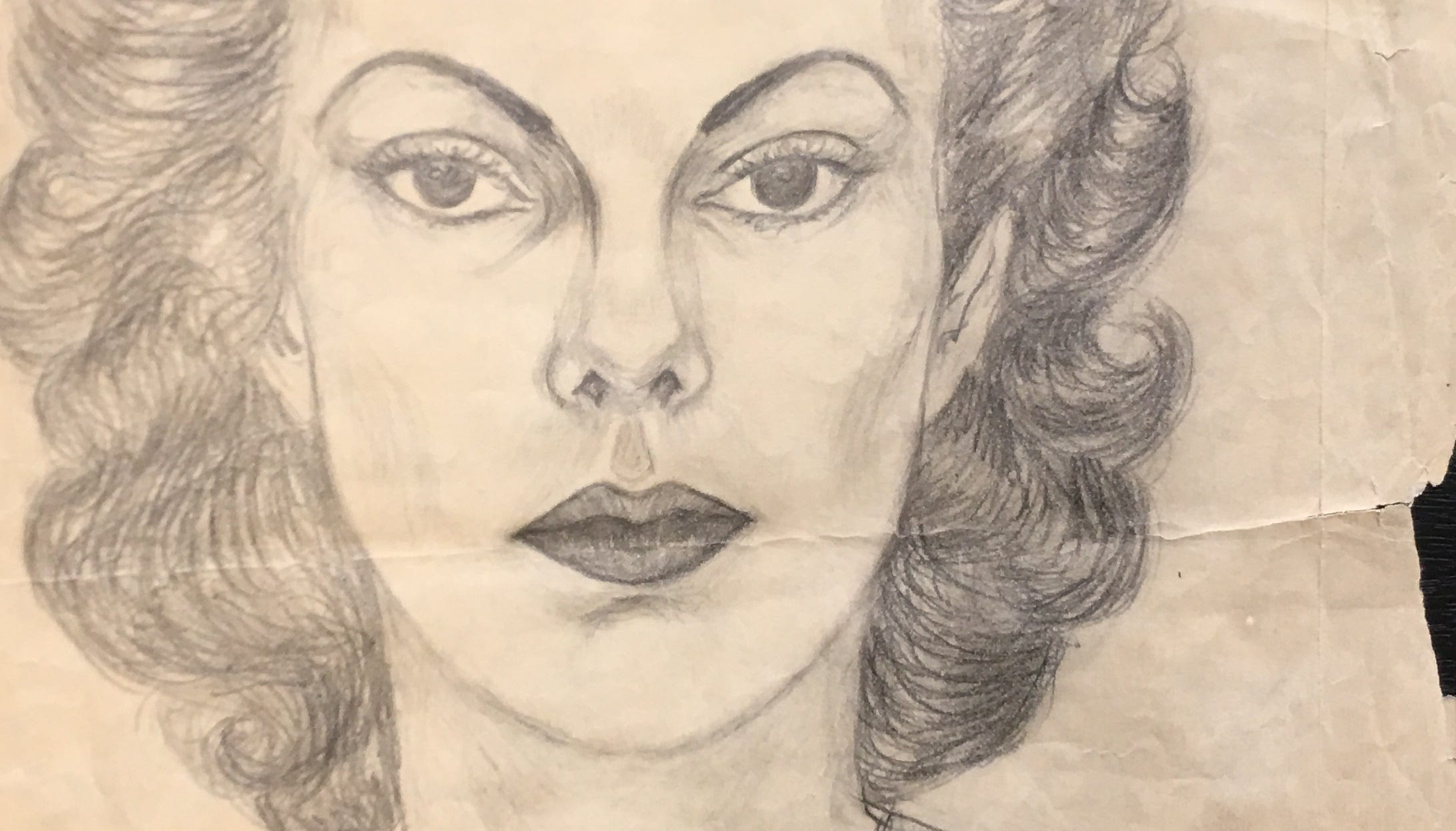"This photo shows a pencil-on-paper portrait of a woman, dated 1940. It was found in 2018 by William Hakala of Reno under a thrift-store painting. He has been looking for any information about who the woman is. The back of the portrait is labeled ""Lia Patlow"" or ""Lia Patlore"" and has a Boise, Idaho address."
