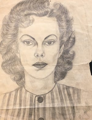 """This photo shows a pencil-on-paper portrait of a woman, dated 1940. It was found in 2018 by William Hakala of Reno under a thrift-store painting. He has been looking for any information about who the woman is. The back of the portrait is labeled """"Lia Patlow"""" or """"Lia Patlore"""" and has a Boise, Idaho address."""