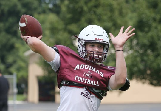 Aquinas quarterback Tyler Szalkowski airs it out during the teams  practice at Aquinas Institute in Rochester on Wednesday, Aug. 15, 2018.