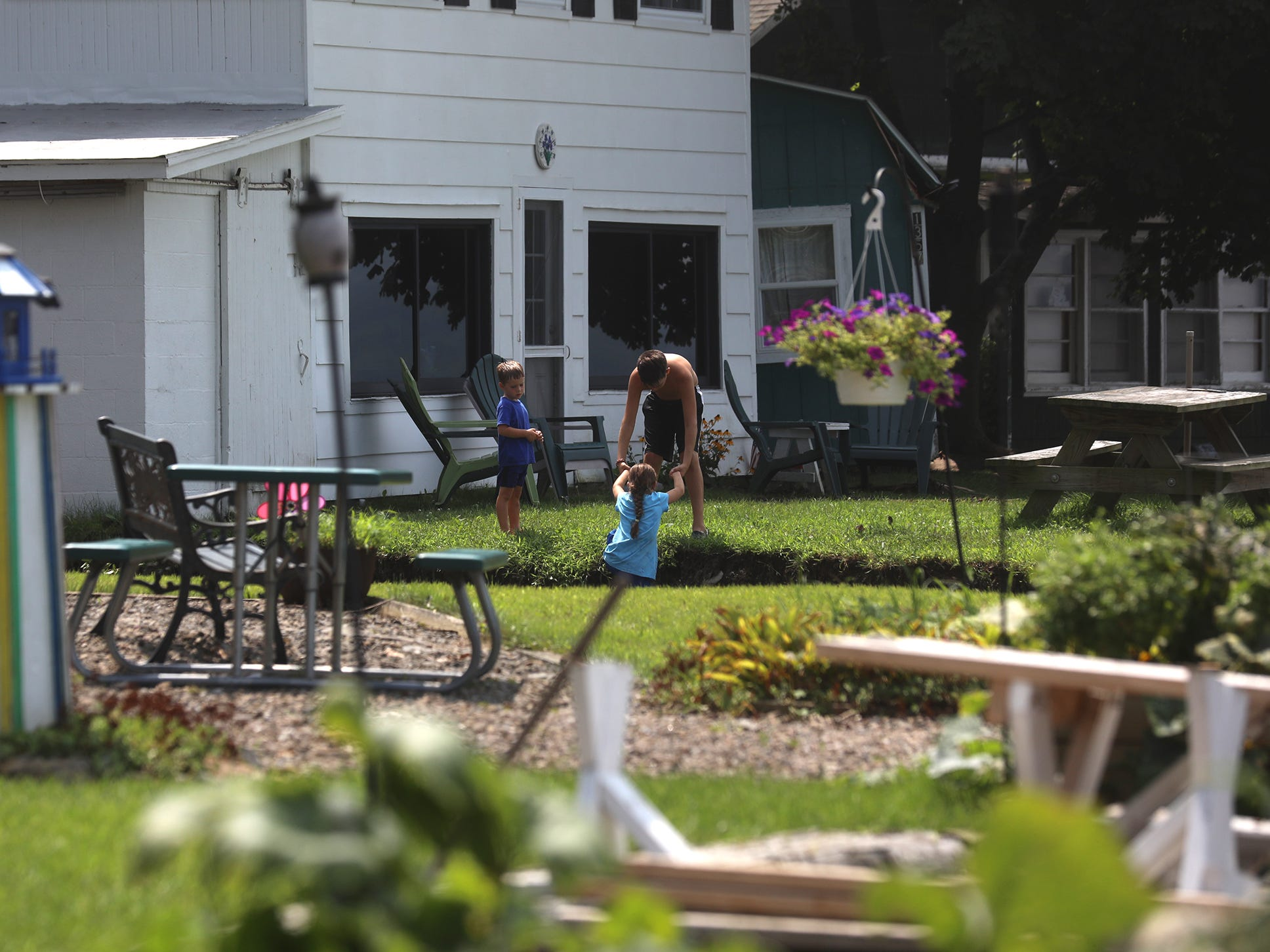 Residents on Lower Lake Road clean up and survey damage to the area at Lodi Point.  Not every home had severe damage.