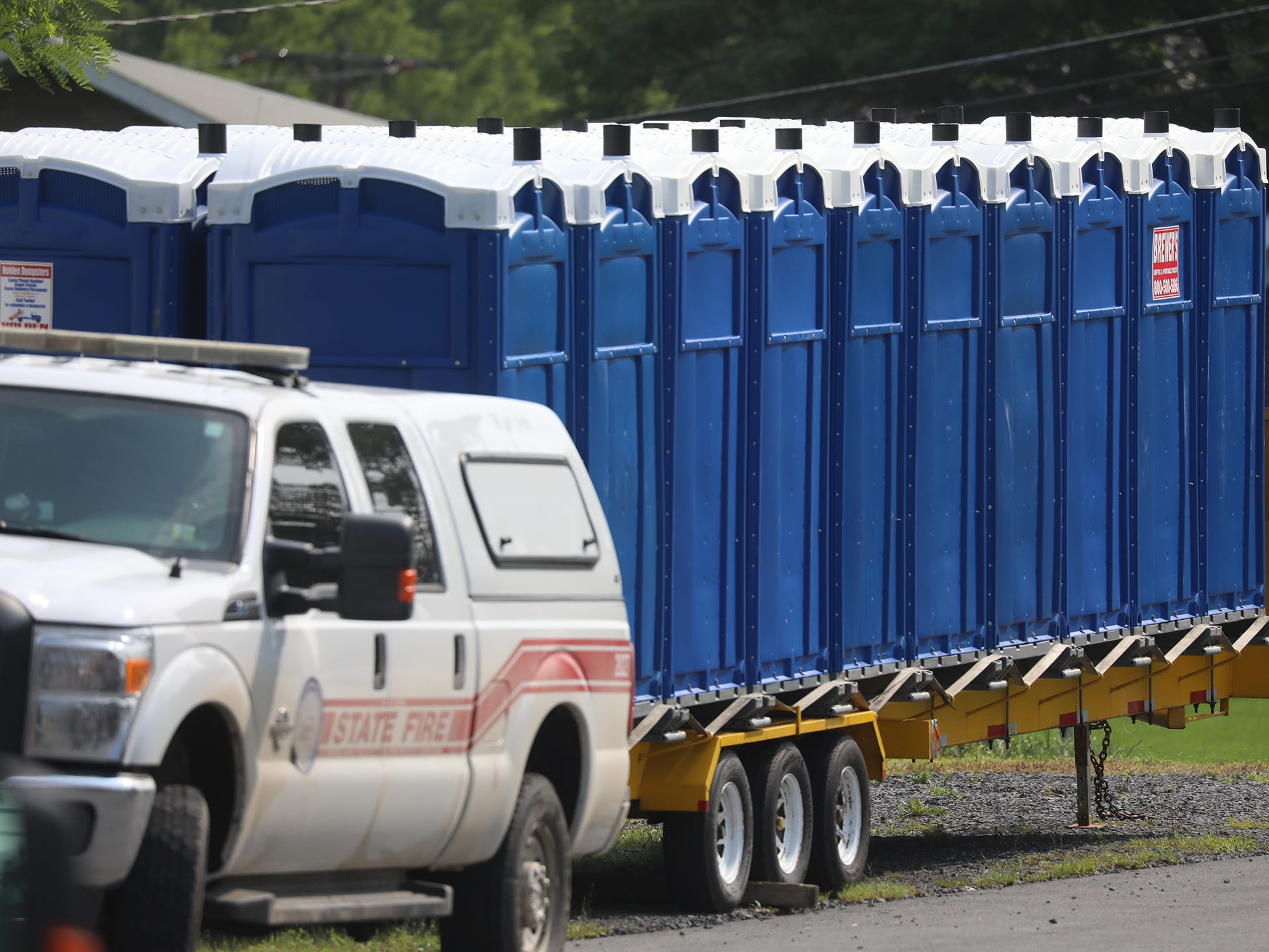 Portable bathrooms wait for deployment from Ovid Fire Department.