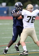 Alex Officer of Eastridge tries to get past Josh Daggs (76) of Greece Athena during a game played Oct. 1, 2011. Officer was a two-time AGR choice for Eastridge and played for the University of Pittsburgh.