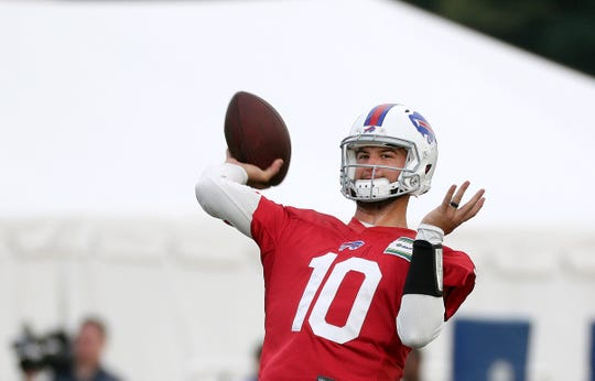 Bills quarterback AJ McCarron lofts a pass to the corner of the end zone during training camp at St. John Fisher. McCarron was traded to the Raiders prior to the regular season starting.