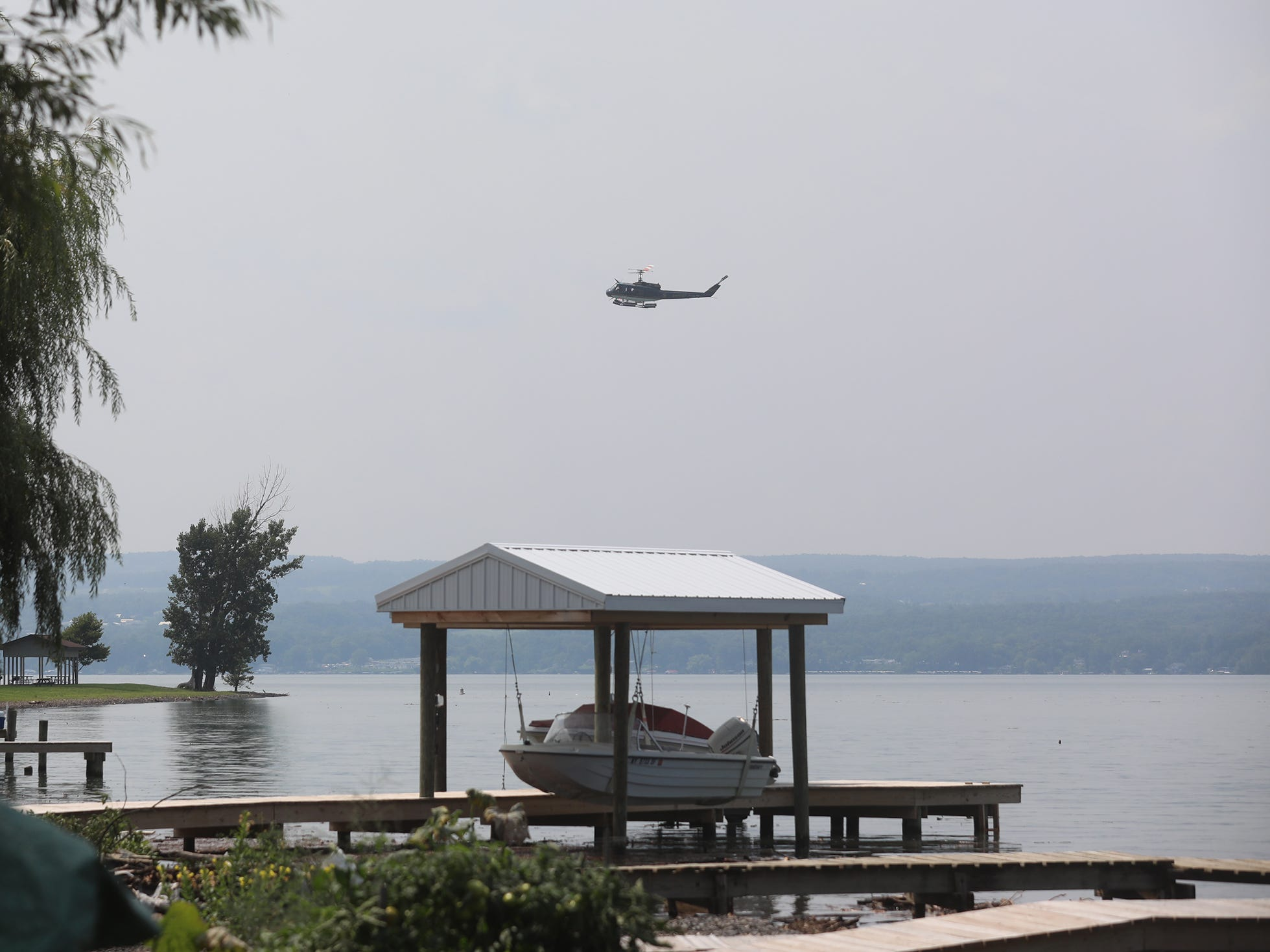 A NY State Police helicopter heads into Lodi State Marine Park to land.  The area of Lodi Point had limited access early Thursday morning because of downed power lines.