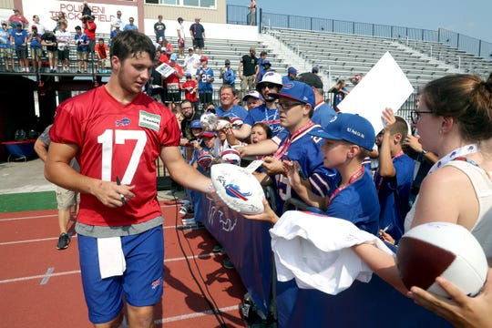 Quarterback Josh Allen signs autographs for fans on the last day of training camp at St. John Fisher College.