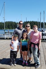 Charlie Clarke and his wife, Shelly, and their three children during a recent visit to Florence.