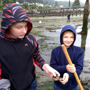 Will, left, and Gus Lederer show off two of their clams after first-ever outing to Garibaldi.