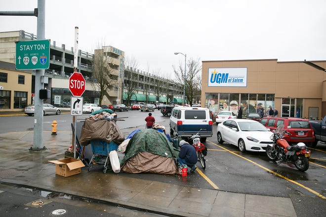 A makeshift camp in the parking lot of Union Gospel Mission on Saturday, Dec. 23, 2017, in downtown Salem. The homeless shelter is expected to move to north downtown in 2020.