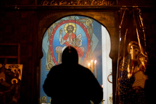 A priest leads prayers before Christmas Eve Mass at the Virgin Mary church in Cairo, Egypt, on Jan. 6, 2018. The killing of a respected bishop in a desert monastery north of Cairo has opened a rare window into the cloistered world of Egypt's Coptic Orthodox Church. It's one of the oldest Christian communities in the world and the one that introduced monasticism to the faith. But the killing of the abbot, and the arrest of two monks suspected in his death, has shaken the church.