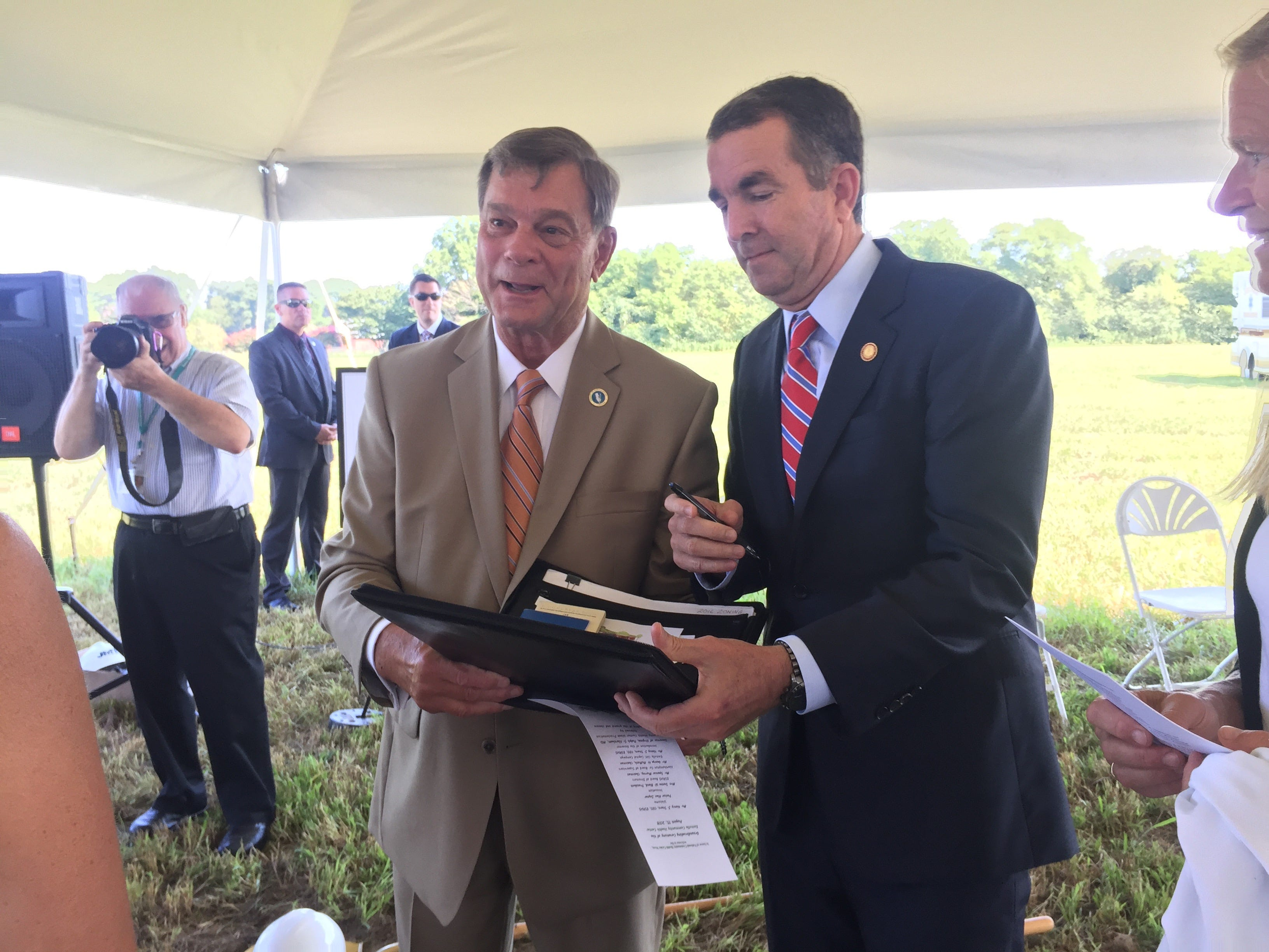 Spencer Murray, left, poses with Gov. Ralph Northam at a groundbreaking ceremony for Eastville Community Health Center in Eastville, Virginia on Wednesday, Aug. 15, 2018.