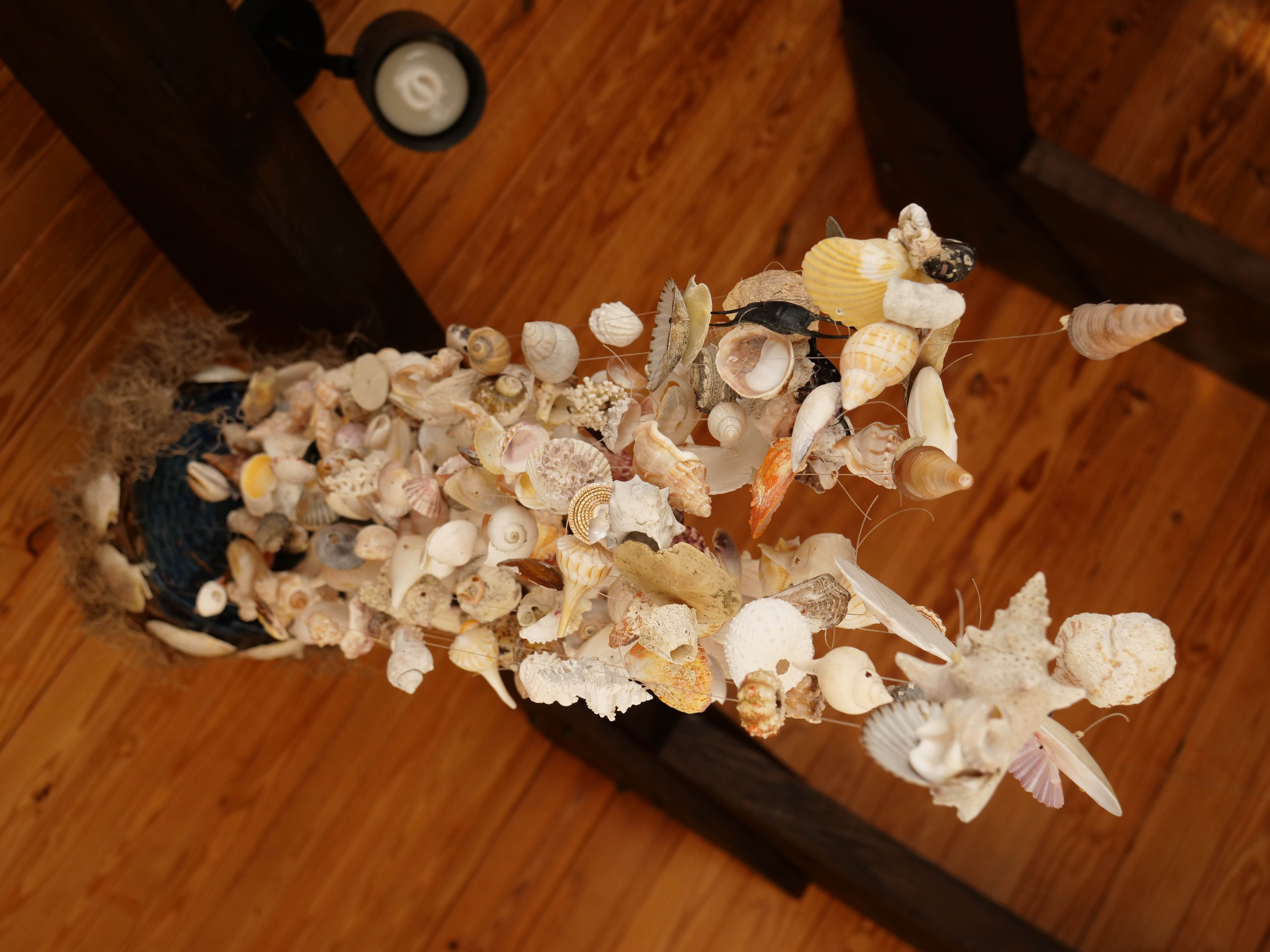 Larry Mann creates all sorts of home decor items from the seashells he has collected over the years.