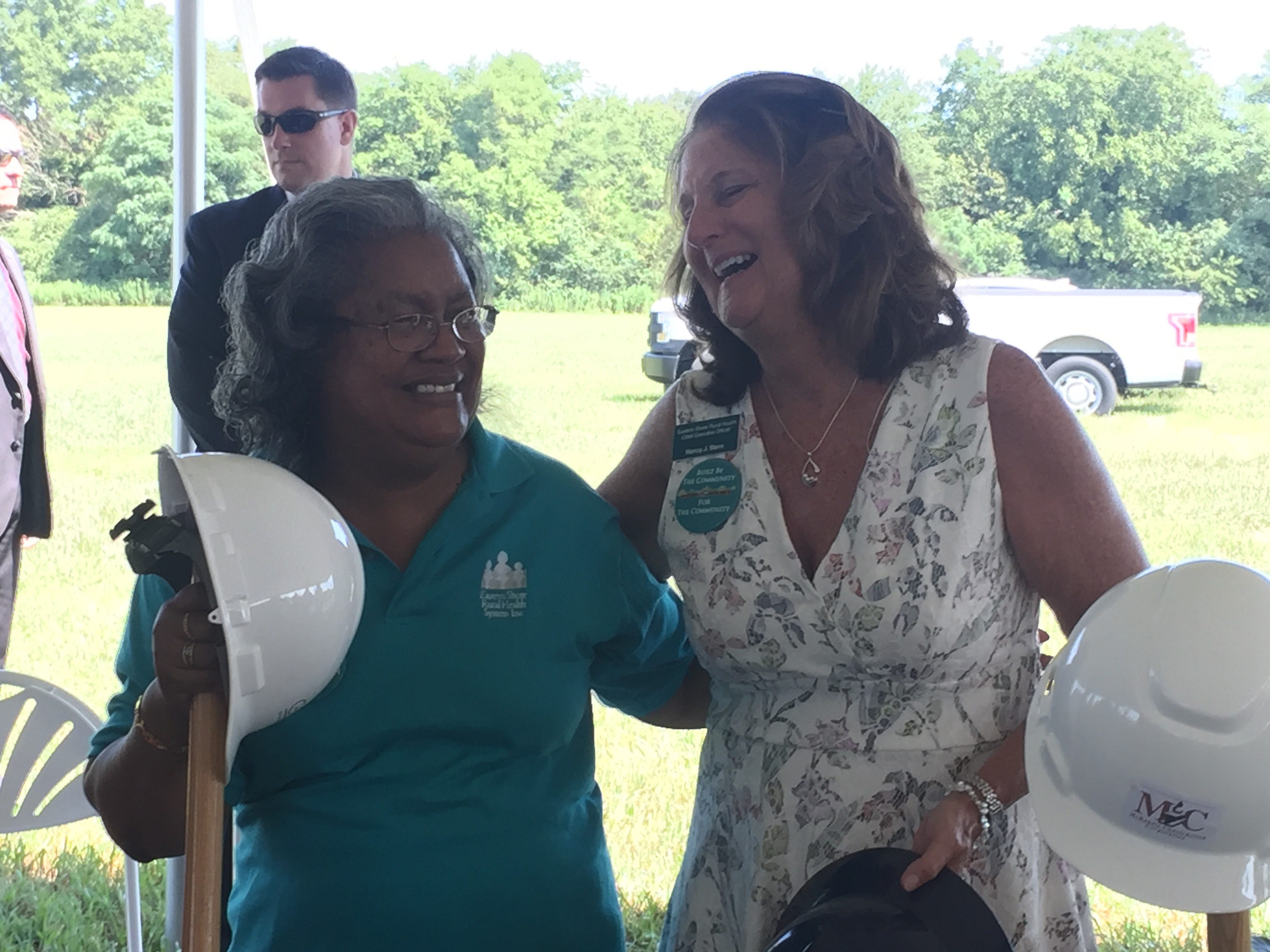 Denise Bland, left, president of the Eastern Shore Rural Health System board of directors, chats with Rural Health CEO Nancy Stern after a groundbreaking ceremony for Eastville Community Health Center in Eastville, VIrginia on Wednesday, Aug. 15, 2018.