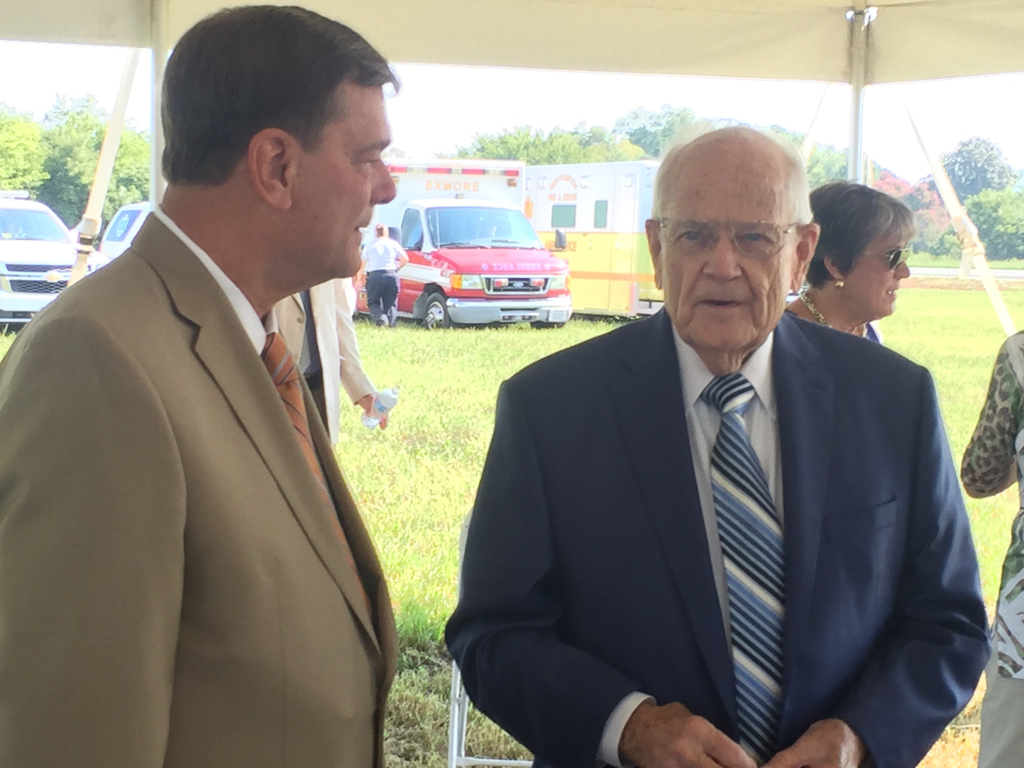 Spencer Murray, left, chats with George McMath before a groundbreaking ceremony for Eastville Community Health Center in Eastville, Virginia on Wednesday, Aug. 15, 2018.