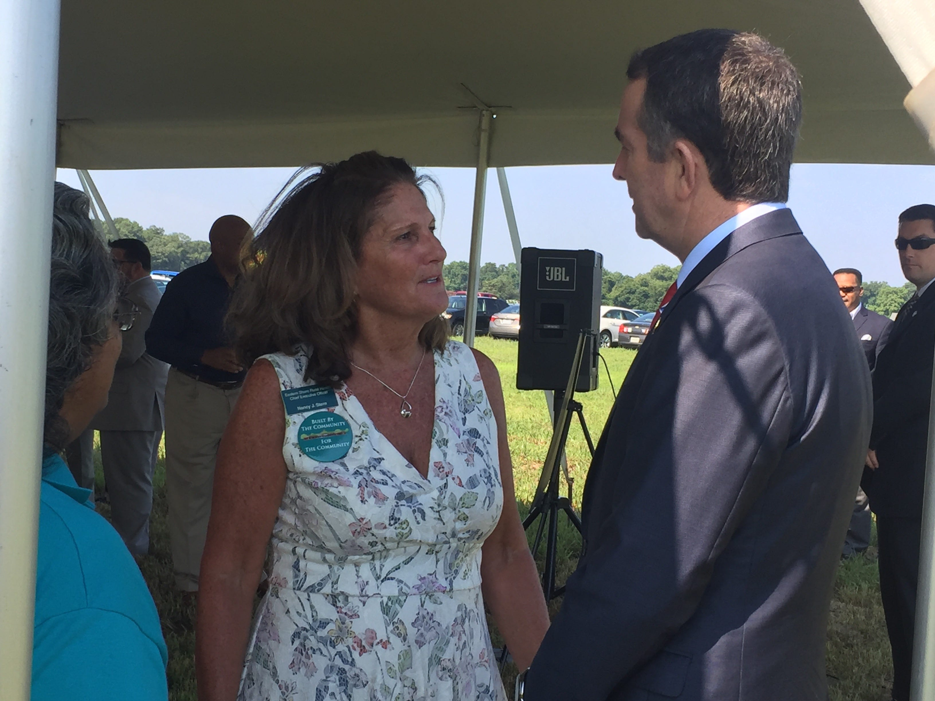 Nancy Stern, Eastern Shore Rural Health System CEO, chats with Gov. Ralph Northam before a groundbreaking ceremony for Eastville Community Health Center in Eastville, Virginia on Wednesday, Aug. 15, 2018.