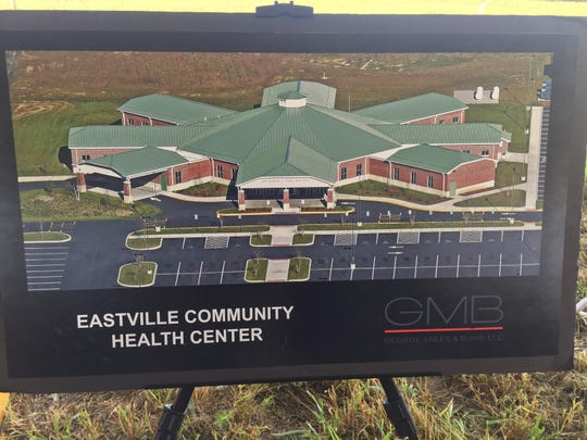 An architectural rendering of Eastville Community Health Center is displayed at a groundbreaking ceremony in Eastville, Virginia on Wednesday, Aug. 15, 2018.