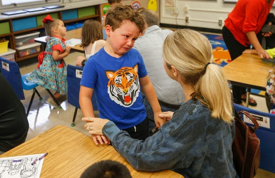 Oscar Hill, a kindergartener at Wilder Elementary School, tears up as he says goodbye to his mom Lori Hill on the first day of school on Wednesday, Aug. 15, 2018.