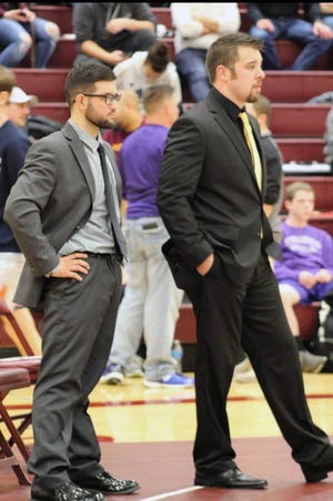 Buffalo Gap assistant wrestling coach A.J. Dobzeniecki, left, and head coach Josh Talbott watch one of their wrestlers compete at the VHSL Class 2, Region B tournament in February. Dobzeniecki has succeeded Talbott as the Bison's head coach.