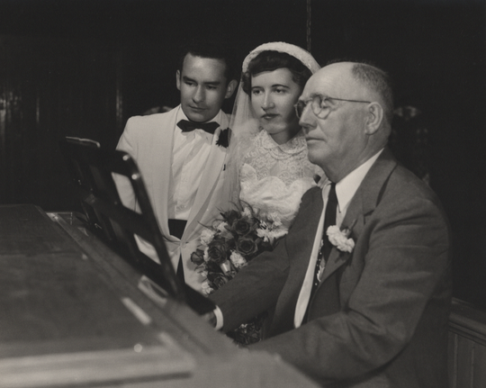 Henry Haehn, left, played the organ and led the choir for his daughter Peggy's wedding, June 15, 1954.