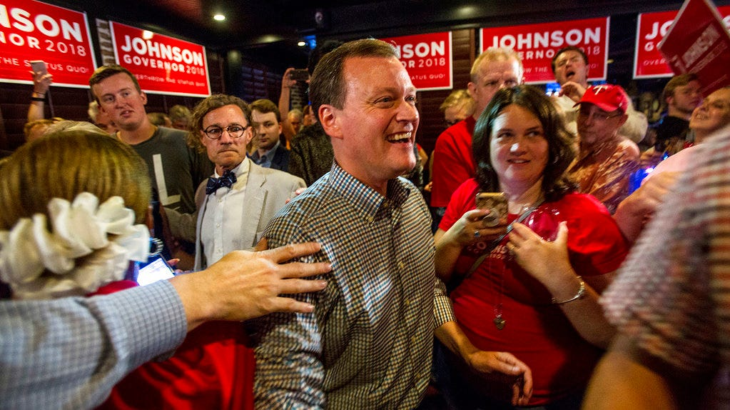 Minnesota gubernatorial candidate Jeff Johnson, center, is greeted by his supporters after returning to the watch party, Tuesday, Aug. 14, 2018, in Plymouth, Minn. (Alex Kormann/Star Tribune via AP)