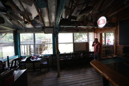 Jeff DuBree, owner of the Whippoorwill, which he opened on Lake Talquin with his father Roland 26 years ago, speaks on the phone as he walks through the shuttered establishment Thursday, Aug 9, 2018. The restaurant recently closed as it faced nearly $100,000 in upgrades to pass local inspections.