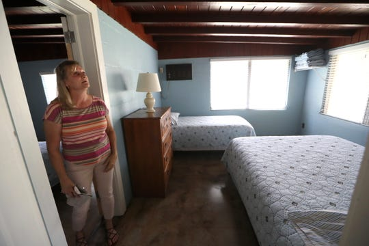 Kathie DuBree straightens up inside one of the family's lakefront rental properties on Lake Talquin Thursday, Aug. 9, 2018. Faced with the closure of the family restaurant, the DuBree's are now deciding whether to spend nearly $100,000 to update and reopen, or concentrate on their other business along the lake.
