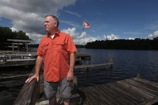 Jeff DuBree, owner of the Whippoorwill, which he opened on Lake Talquin with his father Roland 26 years ago, poses for a portrait omn the dock outside of the establishment on Thursday, Aug 9, 2018. The restaurant recently closed as it faced nearly $100,000 in upgrades to pass local inspections.