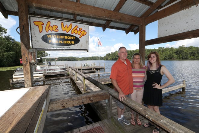 Jeff DuBree, owner of the Whippoorwill, stands with his wife Kathie and daughter Chenoah outside the family restaurant Thursday, Aug. 9, 2018.