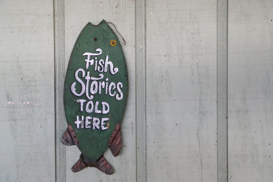 Fishing-themed decorations outside of the recently closed Whippoorwill, longtime restaurant on Lake Talquin.