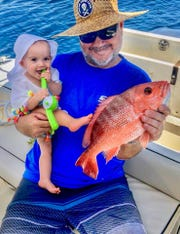 Alden Speedy, 7 months of age, and dad Capt. Brian Speedy of Stuart enjoyed Alden's first red snapper fishing trip.