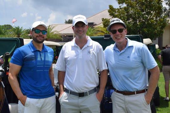 Ben Babcock, left, Luke Webb and George Gray at the Smoke Inn Cigars and Drew Estate Charity Golf Tournament to benefit Hibiscus Children's Center.
