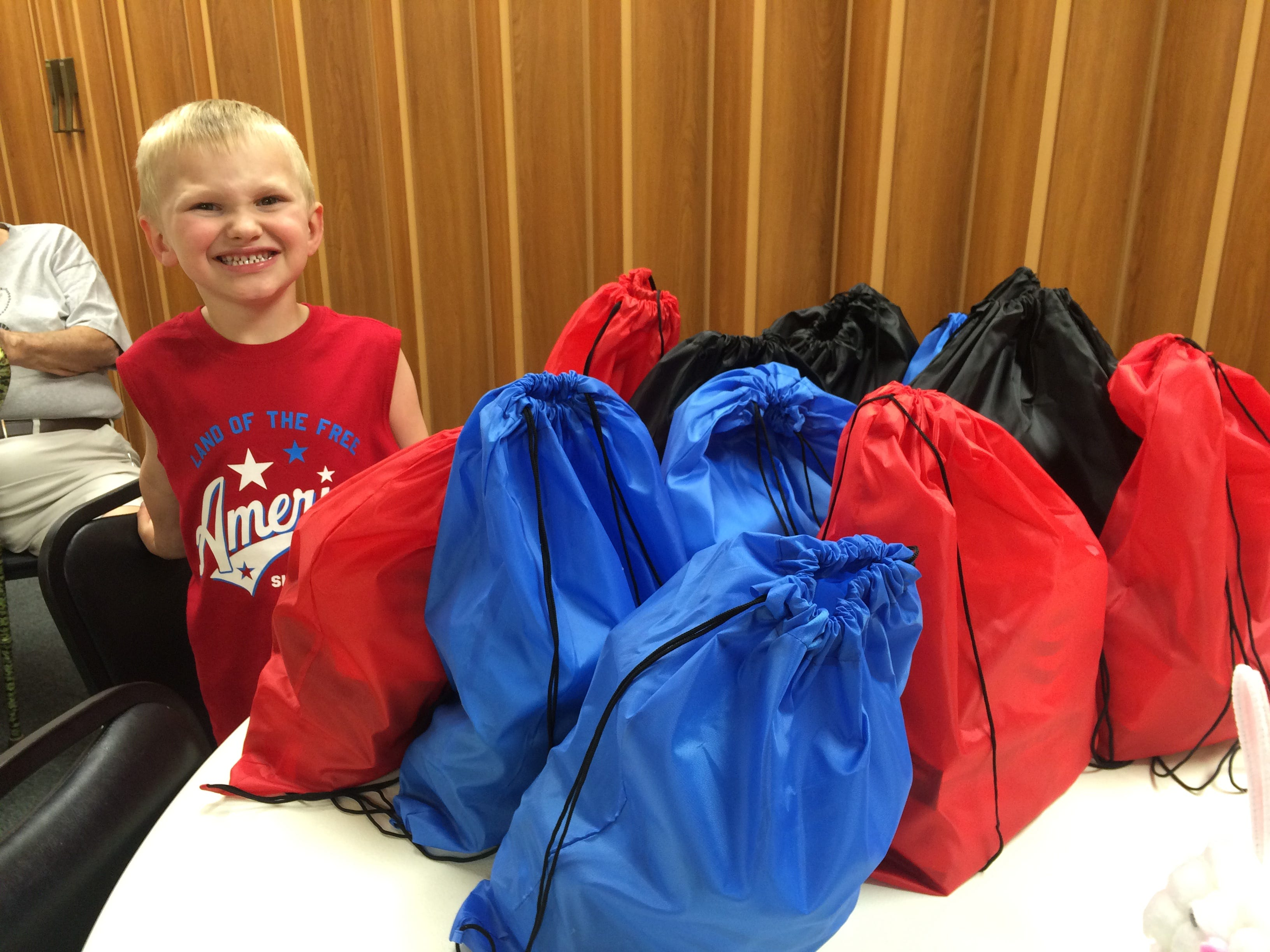 Corbin Odekirk prepares bags of food and toiletries for homeless veterans in January 2017.