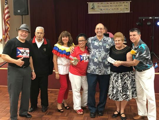 Charlie Quiles, from left,  Luis Carrillo, Nancy Rozon, with 50/50 winner María Quiles, Rubén Alemán, 50/50 winner Roberta Linares and Carlos Mejía.