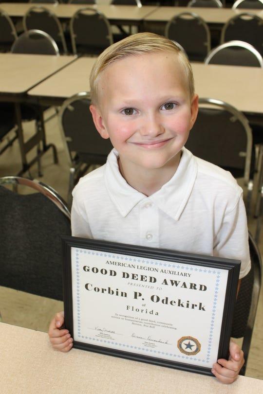 Corbin Odekirk with his Good Deed award.