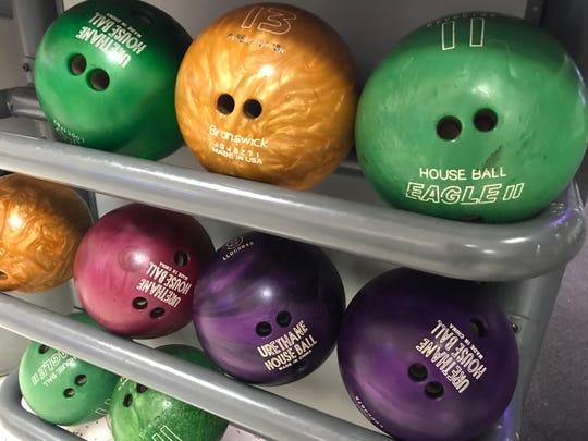 Colorful bowling balls are ready for use at Superplay USA in St. Lucie West.