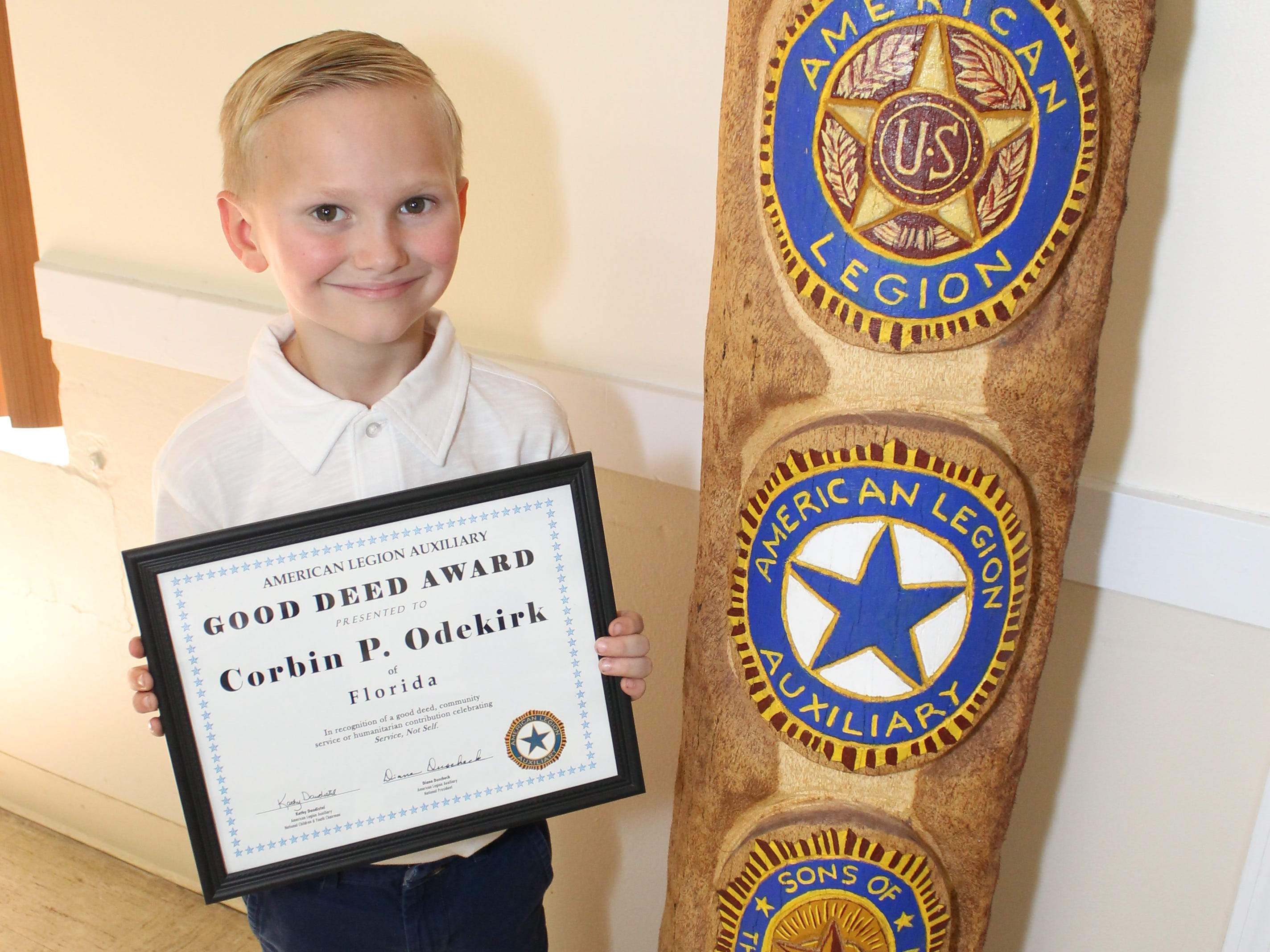 Corbin Odekirk with his Good Deed award