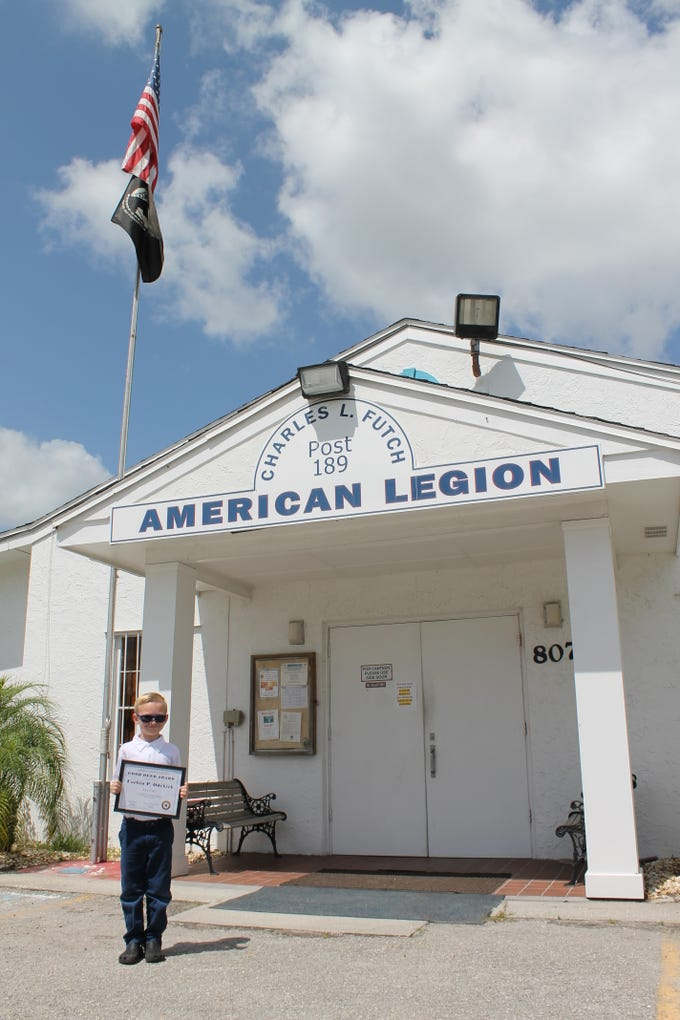 Corbin Odekirk with his Good Deed award in front of the American Legion Auxiliary #189 in Sebastian.