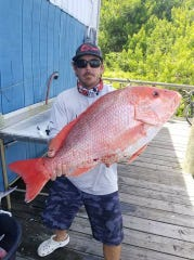 Patrick Ellis scored a 19-pounder Saturday with Little Adam fishing charters in Fort Pierce.