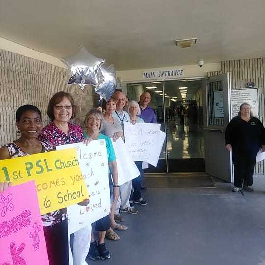 Members of 1PSL Baptist and First United Methodist Church of PSL welcome students and parents back to Northport.