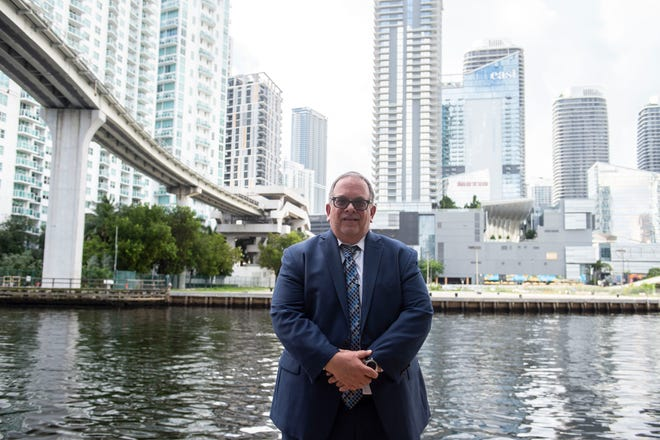 "Immigration attorney Ricardo Skerrett, 57, seen Aug. 7, 2018, along the Miami River in downtown Miami, is a native of Puerto Rico who now lives in Cape Coral and represents individuals, corporations, public and religious institutions and more. ""I've always said immigration, whether illegal or legal, follows the reality of the market. Where there's jobs, people will go. If there's no jobs, people will not go there. Right now the unemployment rate is only (3.9 percent) here, so that means that immigration is going to go down, illegal immigration,"" Skerrett said."