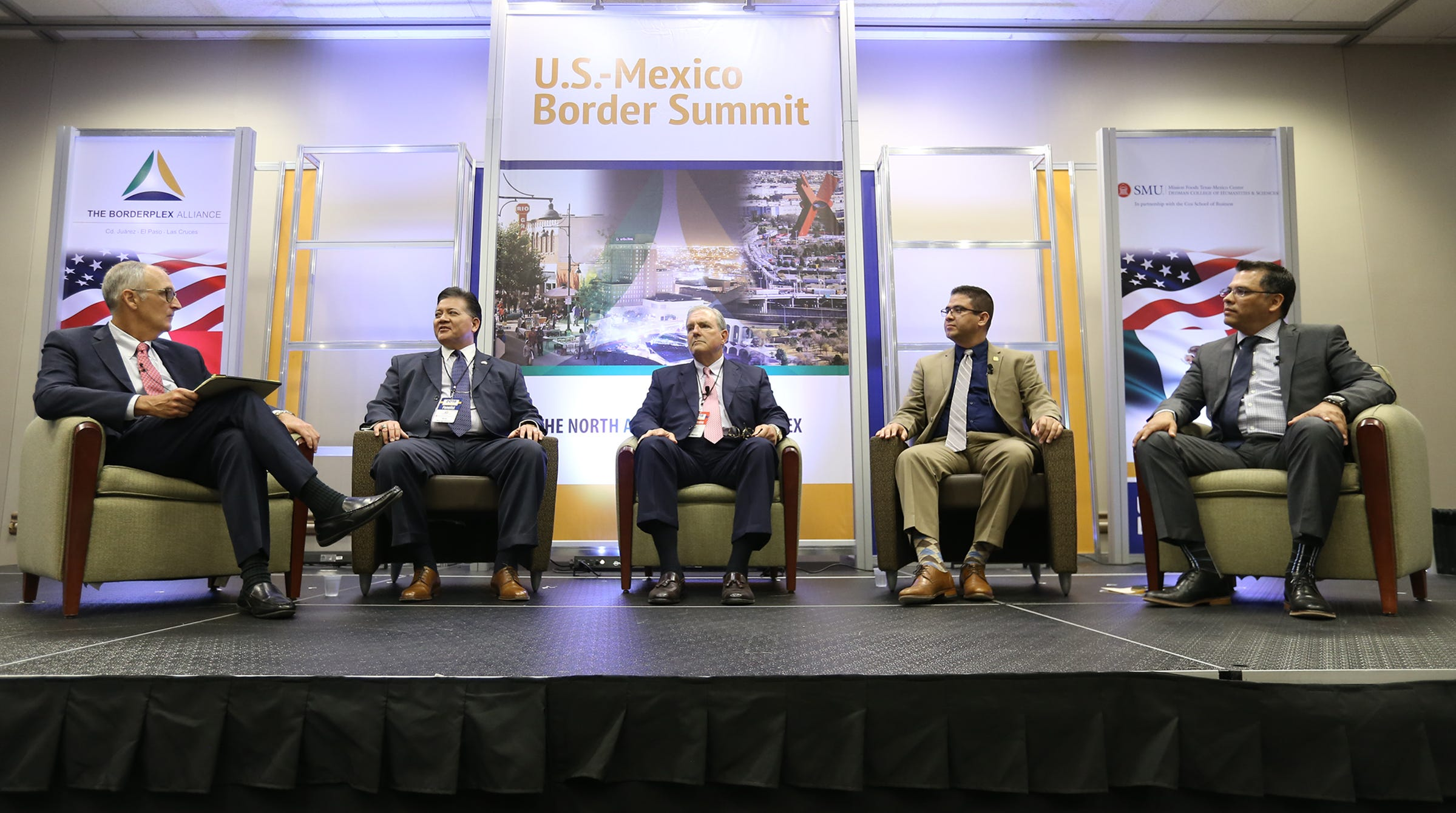 Matthew Myers, left, the dean of SMU's Cox School of Business, leads a panel discussion with border mayors Ken Miyagishima of Las Cruces, Dee Margo of El Paso, Javier Perea of Sunland Park, N.M., and Roberto Rentería Manqueros, mayor pro tem of Juárez.