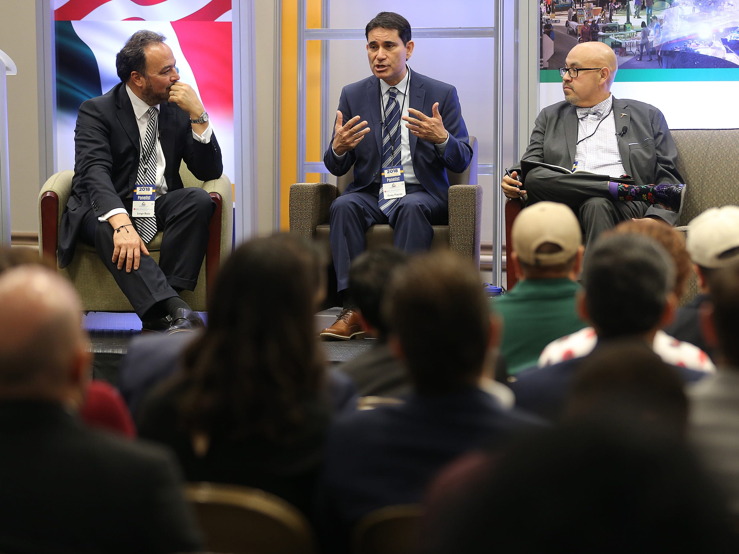 Jorge Ruiz, left, moderator of the panel 'What's Next? The Future of U.S.-Mexico Relations,' listens with Richard Pineda, right, as Tony Payan, Director of the Mexico Center at the Baker Institue at Rice University, makes a point on NAFTA during the U.S.-Mexico Border Summit Wednesday